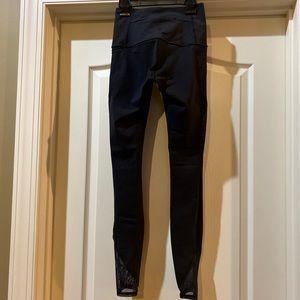Lululemon Black Leggings with sheer pockets size 4